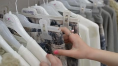 Teen Girl chooses Clothing while Shopping in Store - Clothes at the Trempels Stock Footage