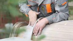 Sanding wood with sandpaper Stock Footage