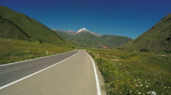 Mountain road from bike Stock Footage