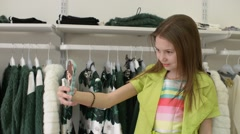 Beautiful Girl brunette makes Selfie Phone Mobile shopping in clothing store Stock Footage