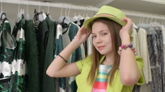 Beautiful girl in a green dress posing while shopping in a store Stock Footage