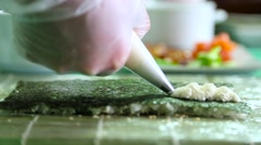Sushi master pours nori with cream cheese Stock Footage