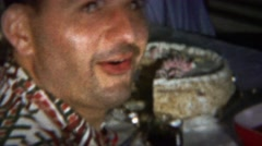 1964: Sweaty Italian man eating cake disturbed embarrassed. Stock Footage