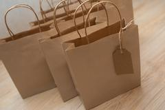 Brown paper bags for holiday gifts Stock Photos