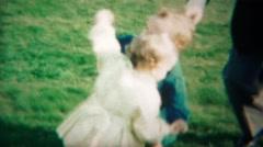 1964: Happy babies wrestling dancing outdoor park lose interest. Stock Footage