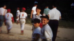1964: Little league baseball boys team yankees leaving field. Stock Footage