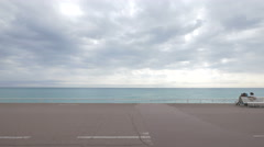 Cloudy day on a beach at Bay of Angels in Nice Stock Footage