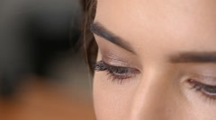 Beautiful woman with curly hair and aero make up.  Close up. Slow motion Stock Footage