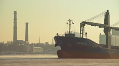 Stock Video Footage of Bulk carrier leaving port of Riga during winter