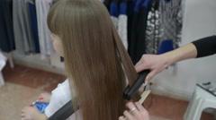 Hairdresser Stylist straightens long Hair Brunette Girl Model before Photoshoot - stock footage