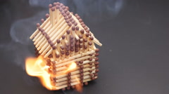 Burning match house slow motion 120fps Stock Footage