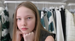 Beautiful Girl Model looks at the Camera serious and fun smiling - stock footage