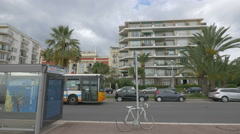 Traffic in front of the beachfront buildings on a cloudy day in Nice - stock footage