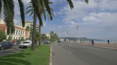 Traffic on a sunny day at Bay of Angels in Nice - stock footage