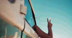 Hipster young adult girl showing peace sign with hand - stock footage