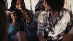 Hipster friends taking pictures in a van during road trip Stock Footage