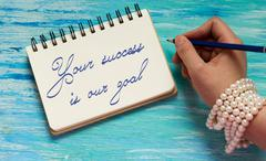 Your Success Is Our Goal Inspirational quote women's hand lettering for p Stock Photos