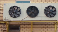 Industrial air conditioning sustem on the wall outdoors. Rotating fans Stock Footage