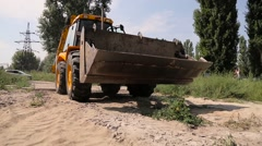 Yellow bulldozer with bucket on the move Stock Footage