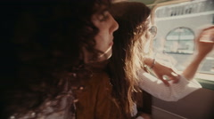Young hipster couple enjoying a road trip on vintage van Stock Footage