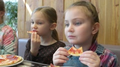 Children eating pizza hands Stock Footage
