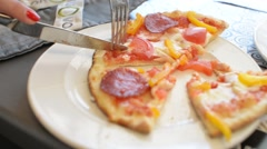 Slicing Pizza On A Plate with Fork and Knife Stock Footage
