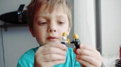 beautiful child plays LEGO men - stock footage
