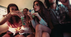 Hipster friends having bubbles party inside a vintage van - stock footage