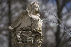 Romance, fountain shaped figure angel water jets coming out of breasts and mo Stock Photos