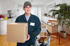 Delivery postman. - stock photo