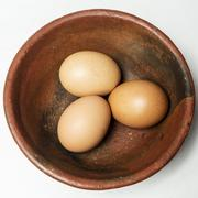 three eggs in a bowl - stock photo