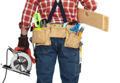 Builder handyman with electric saw. - stock photo