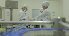 Conveyor With Bottles At Pharmaceutical Factory (4K) - stock footage