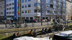 Even though it´s still cold outside people are enjoying the sun Stock Footage