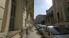 Cars parked on Rue Cronstadt, near Saint-Pierre d'Arene Church, Nice Stock Footage