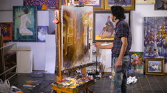 Stock Video Footage of Inspiration. Colorful professional artist paints with oil. Workshop