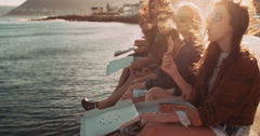 Hipster style teenager friends eating pizza on the dock Stock Footage
