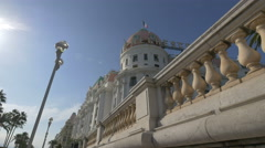 Le Negresco Hotel seen on Promenade des Anglais on a sunny day in Nice Stock Footage