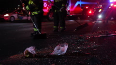 The accident on the highway. firefighters collect broken glass - stock footage