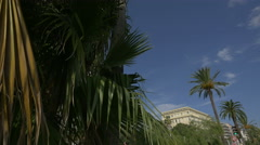 Palm trees in front of Le Negresco Hotel in Nice Stock Footage