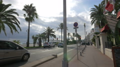 Driving in front of Le Siècle Restaurant and West End Hotel in Nice Stock Footage
