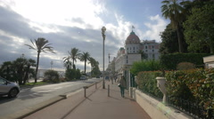 Driving on Bay of Angles in front of Jardins du Musée Masséna, Nice Stock Footage