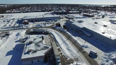 4k aerial transport truck unloading in industrial area in the winter Stock Footage