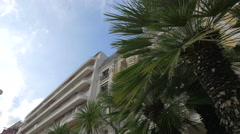 Low angle view of Le Royal Hotel on Bay of Angels in Nice Stock Footage