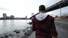Black male walking along the NYC coast. Stock Footage