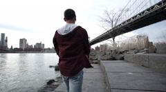 Black male walking along the NYC coast. Stock Footage