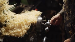 a worker turns the handle of the machine - stock footage