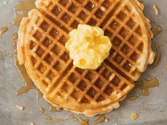 rustic traditional waffle with butter and maple syrup - stock photo