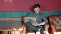 A young man sits in the English pub and browses the Interne Stock Footage