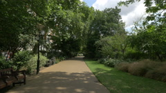 View of an alley in Victoria Embankment Gardens in London Stock Footage